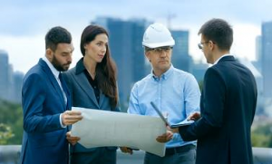 project manager looking at plans with 3 other people